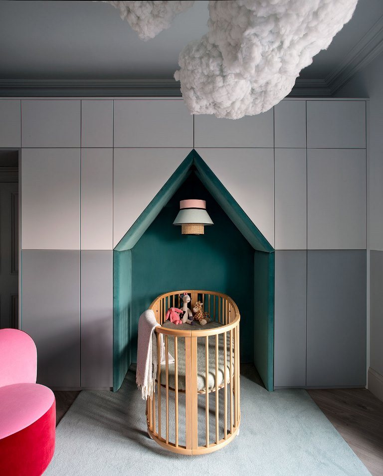The nursery features both bold colors, geometry and looks amazing