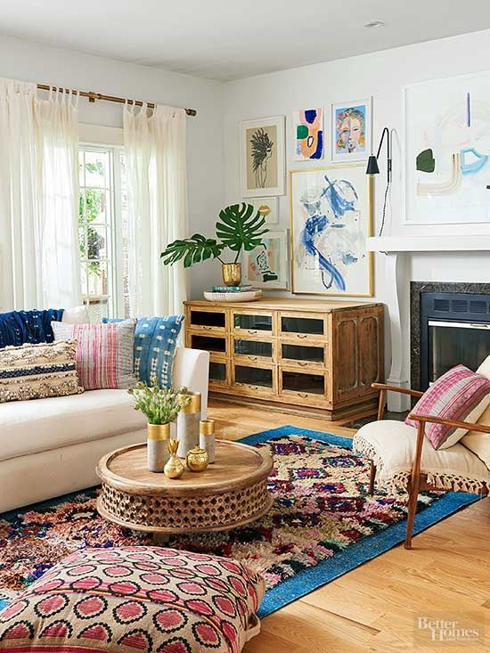 a global style living room in neutrals but with colorful and printed textiles and a bold gallery wall