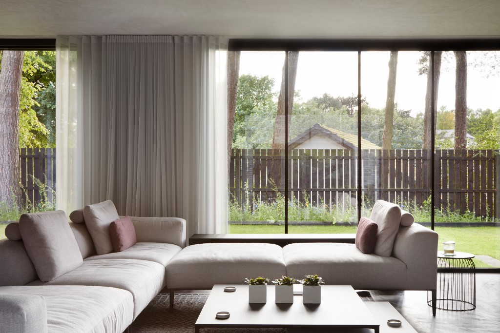Muted furnishings help retain focus on the building materials and views outside