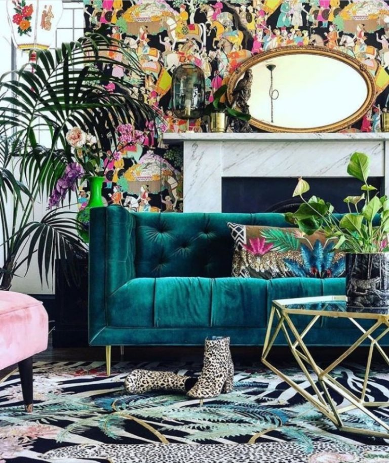 13 a luxurious maximalist living room with colorful wallpaper, bright rugs and pillows, potted plants and gold touches