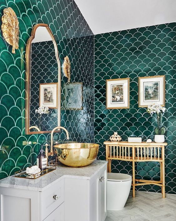 an emerald fish scale tile bathroom, with white appliances and gold touches here and there is very elegant