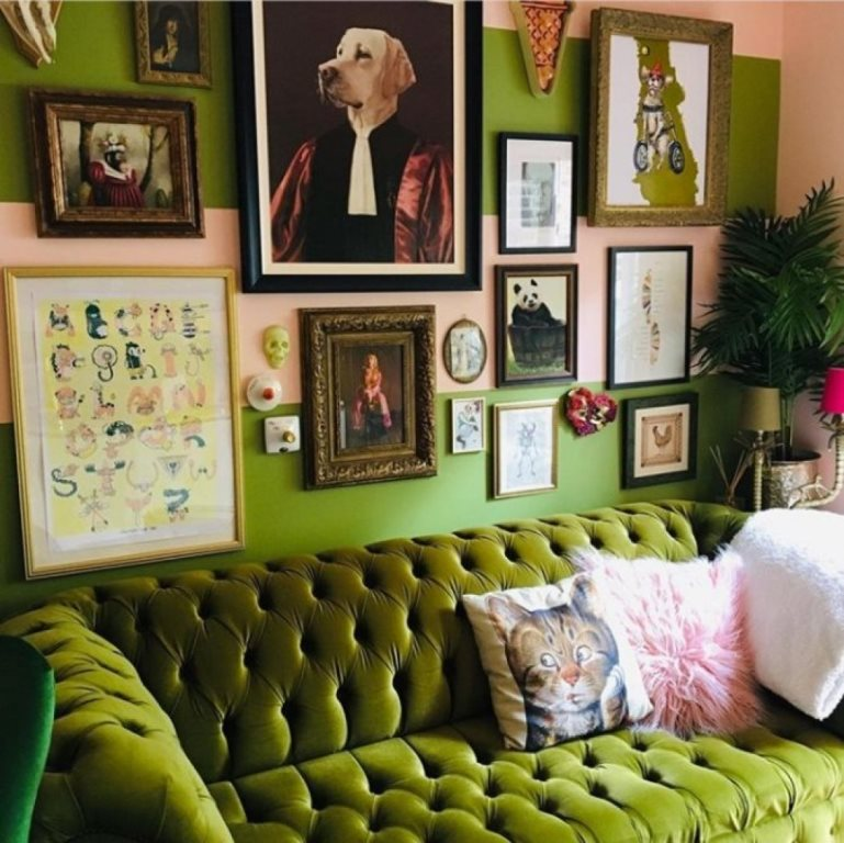 a bold maximalist living room with green walls and furniture, a gallery wall with bright artworks and potted plants