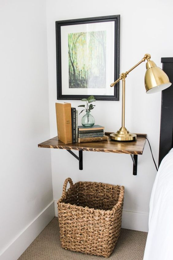 a floating rich stained shelf as a nightstand is a cozy and cool idea for a mid-century modern bedroom