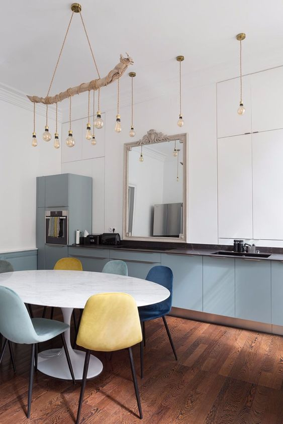 pendant bulbs and a drftwood chandelier with matching bulbs plus blue cabinetry for an absolutely innovative coastal kitchen look