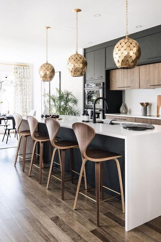 a stylish black and white contemporary kitchen with jaw dropping gold scale pendant lamps is jaw dropping