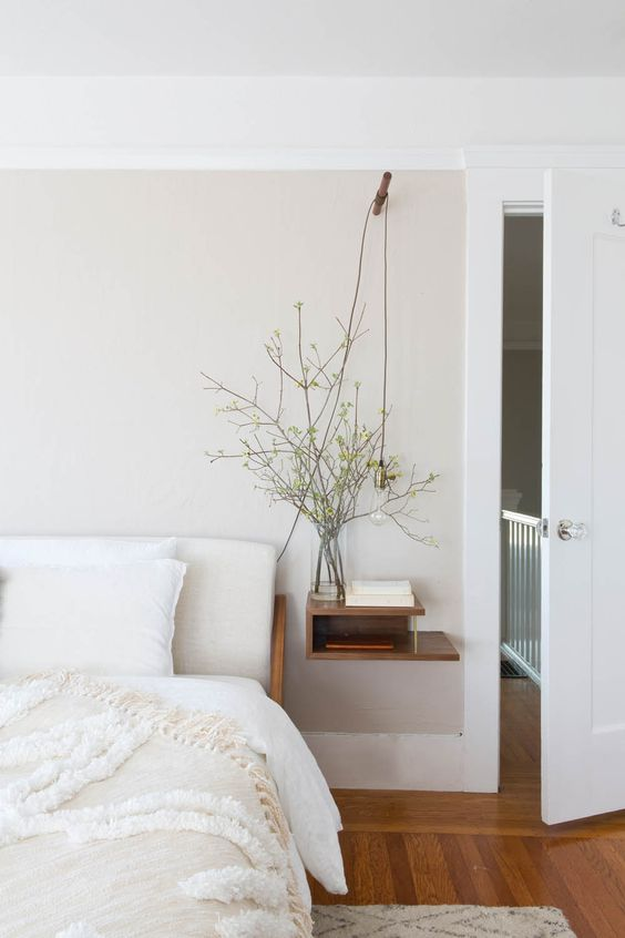 a calming and welcoming bedroom with a floating sleek nightstand with storage space is amazing