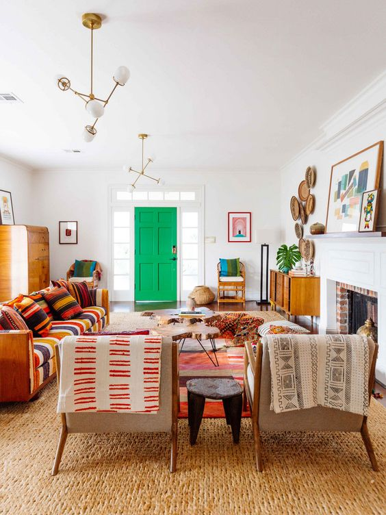 a colorful global style living room with bright printed folksy textiles, decorative plates and bright artworks