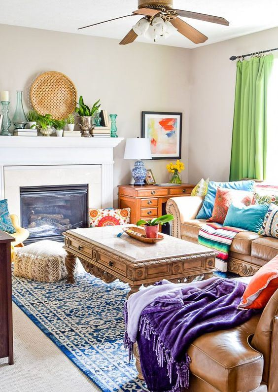 a bright global style living room with colorful printed folksy textiles, bright artworks and a decorative woven plate