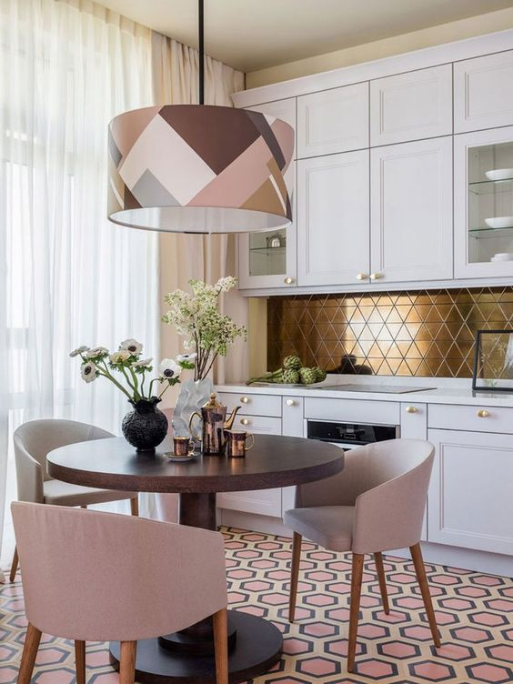 a modern glam kitchen in white, with a gold geometric backsplash and a catchy geometric pendant lamp to rock