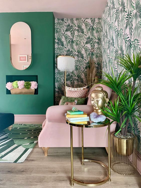 26 a cheerful living room in green and pink, with tropical wallpaper, pink furniture and green walls