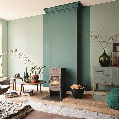 30 a stylish Japandi living room with olive green walls and a dark green accent, simple and modern furniture