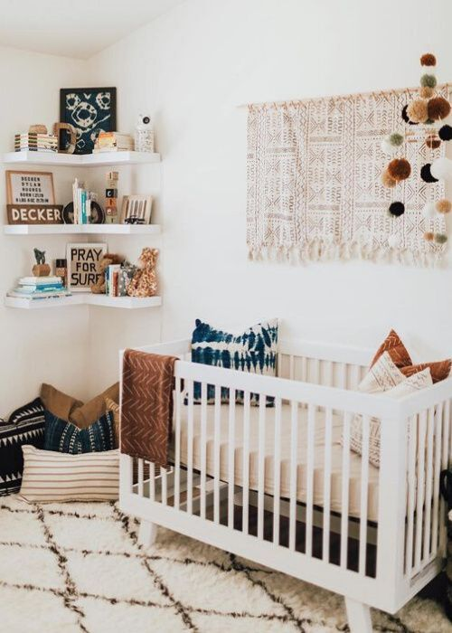 an earthy tone nursery done with neutrals and indigo blue, with printed textiles and open shelves