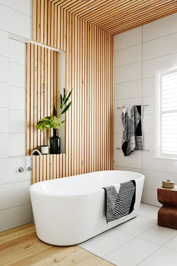 37 a stylish contemporary bathroom with large scale white tiles and a wood slab wall and ceiling is very chic