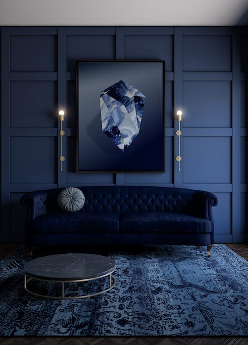an exquisite navy living room with a refined midnight blue sofa, a cool artwork and a marble coffee table