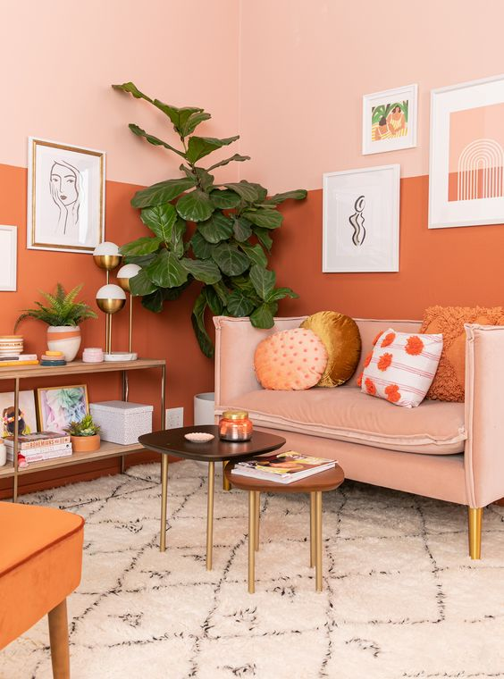 42 a gorgeous warm-toned living room with color block walls, a blush sofa and an orange chair plus cool artworks