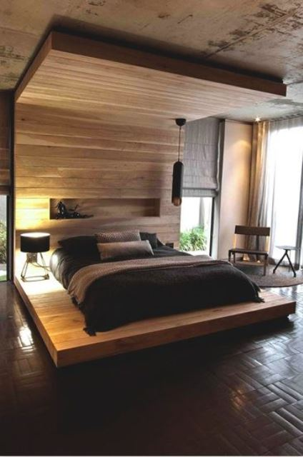 a Japandi bedroom with a statement bed with a canopy over the bed clad with wood and a niche for storage