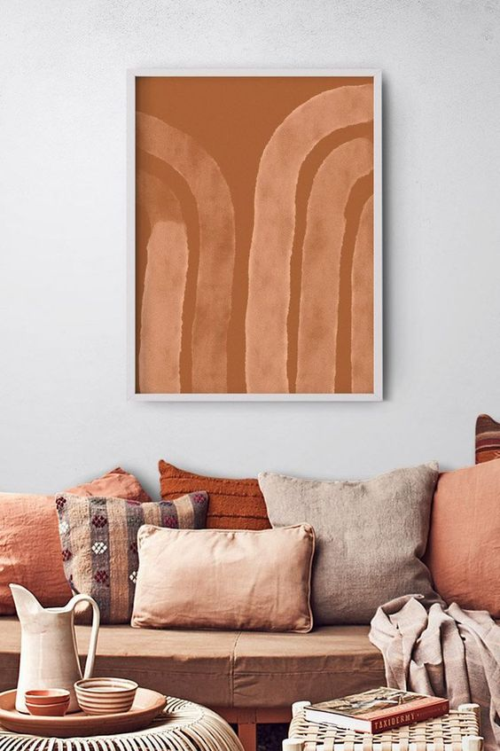 49 a welcoming warm-toned living room with a brown sofa and terracotta pillows, blankets and accessories