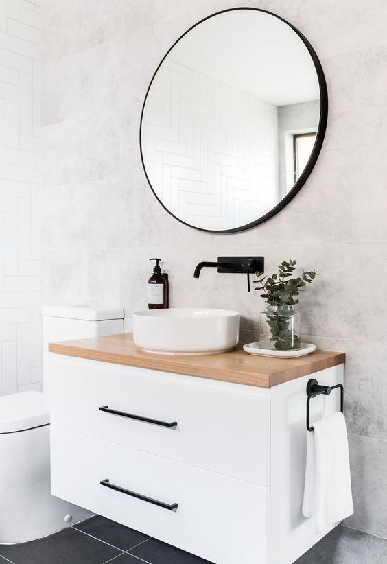a compact white floatign vanity with a stone countertop will give you some storage space without taking any floor space