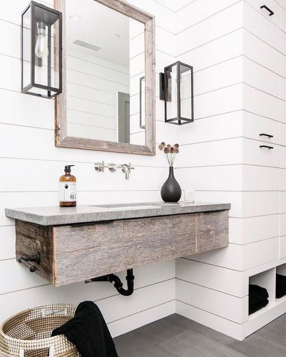 77 a rustic bathroom in neutral, with a floating rough wood vanity and a grey stone countertop is very cool