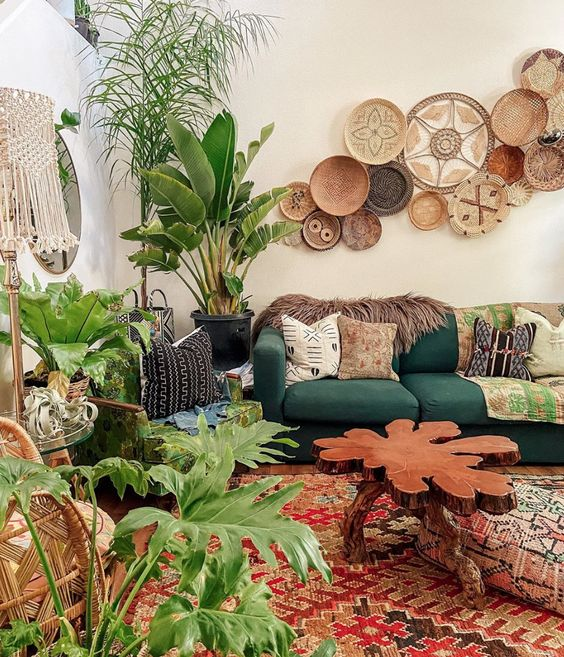 a bright boho living room with decorative baskets, pretty furniture and lots of potted plants to feel fresh