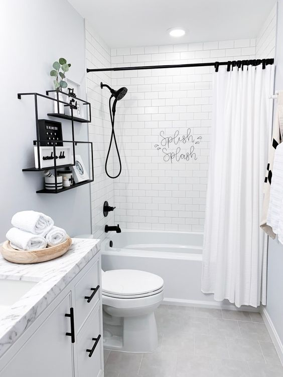 black fixtures and shelves make this neutral bathroom eye-catchy and bold