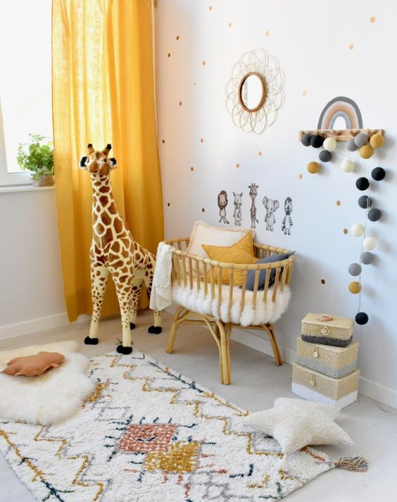 a bright and cool nursery with a polka dot wall, bright rugs, a crib with pillows, some toys and touches of yellow