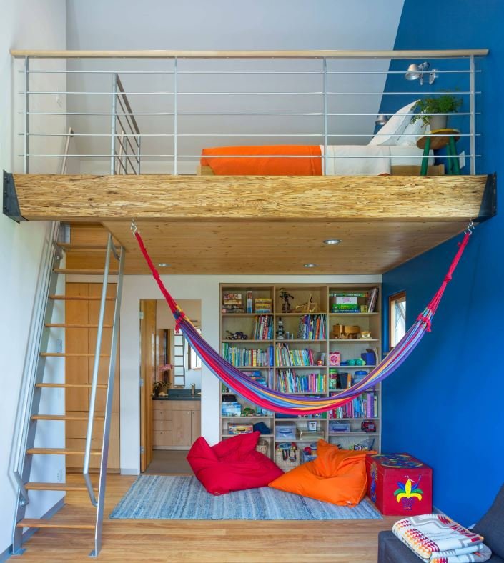 a colorful kids' space with a lower level for reading and just relaxing and the upper level as a bedroom