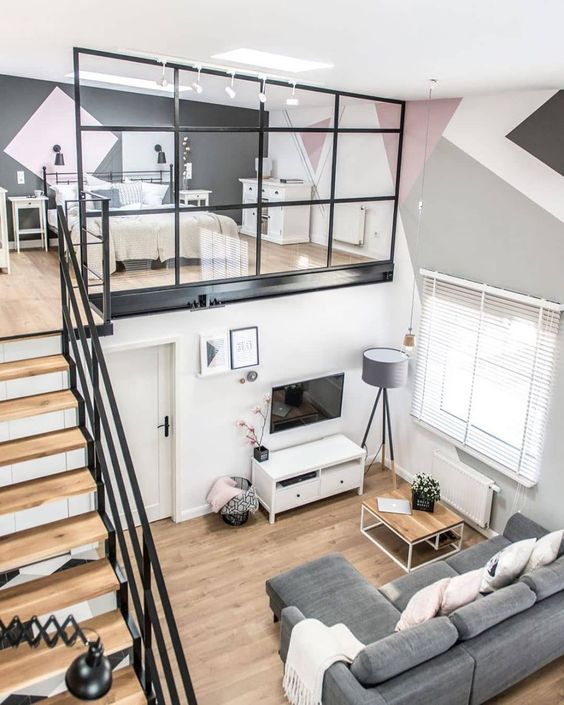 a contemporary apartment with a loft bedroom with skylights and enough space for storage is very cozy