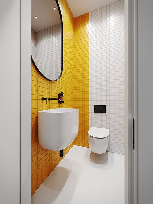 a minimalist bathroom with a yellow tile accent wall, black fixtures and a black frame plus white appliances looks bold