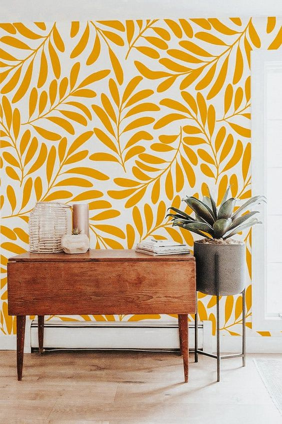 yellow botanical print wallpaper, a mid-century modern console, a potted plant to spruce up a small awkward nook