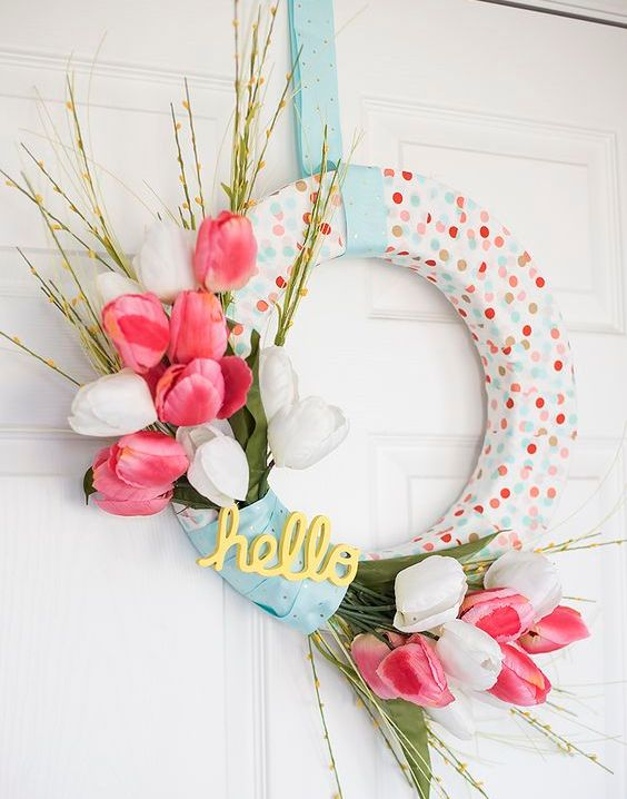 a cute and simple spring polka dot wreath with pink and white faux tulips and greenery is very cute