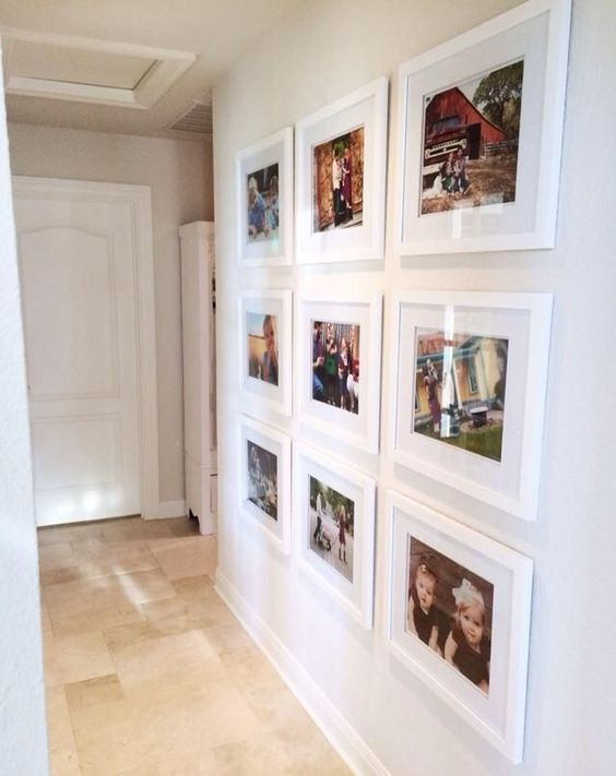 a cool modern grid gallery wall with colorful family pics is a stylish and fresh idea for a modern space