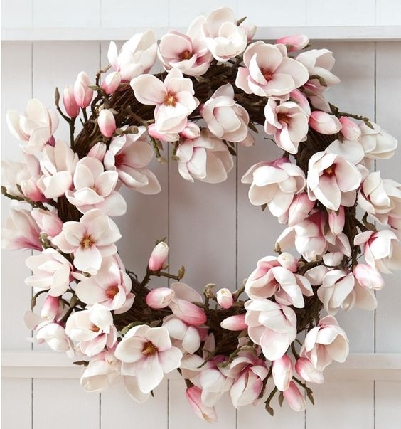 a faux cherry blossom wreath is a stylish and cool idea for spring, it will make your front door look romantic