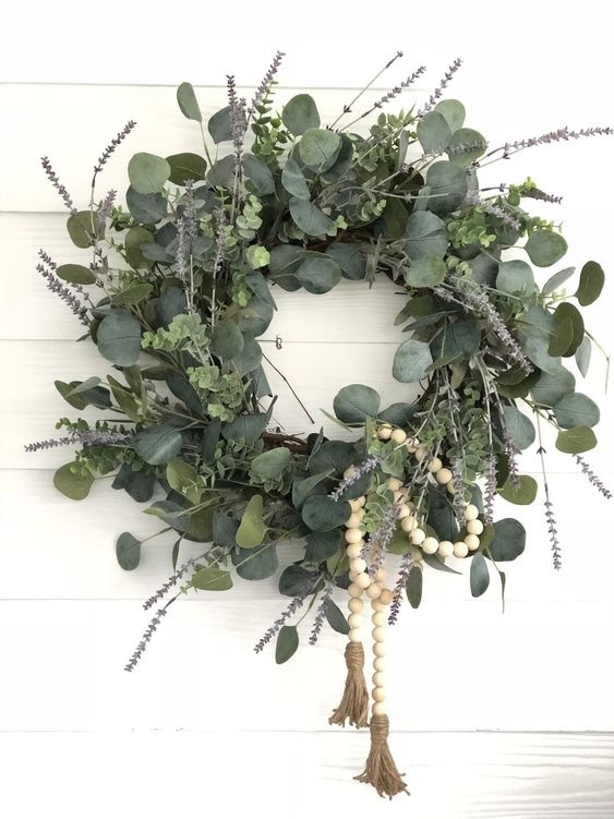 a gorgeous artificial lavender and eucalyptus wreath with wooden rosery is a lovely and very fresh idea for spring