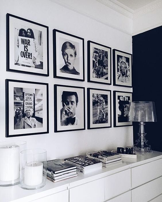 a gorgeous gallery wall with a grid shape and matching black frames is a cool solution for any modern space and it brings chic here