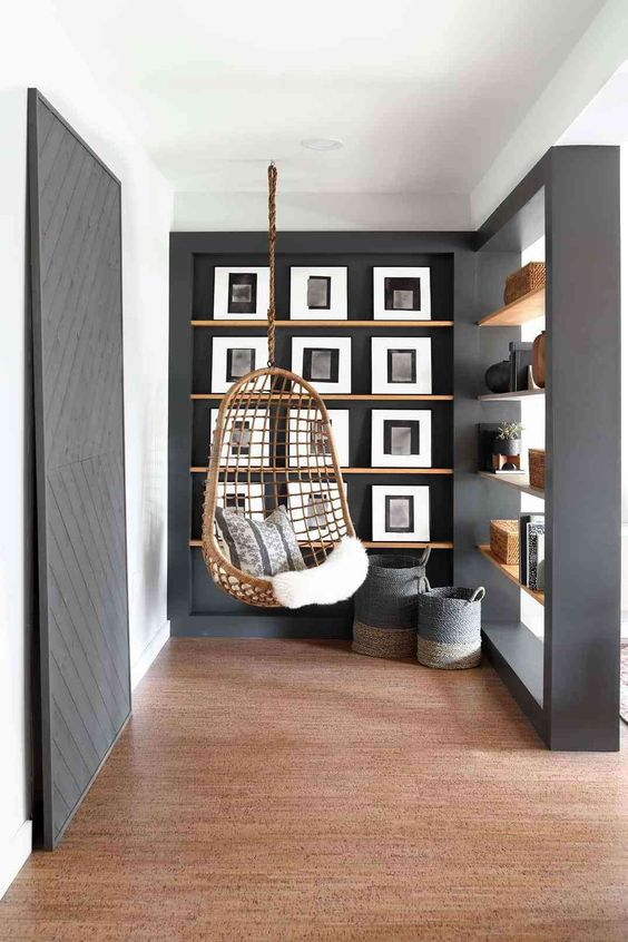 a modern black and white gallery wall on stained ledges looks refined and chic and is easy to compose thanks to ledges