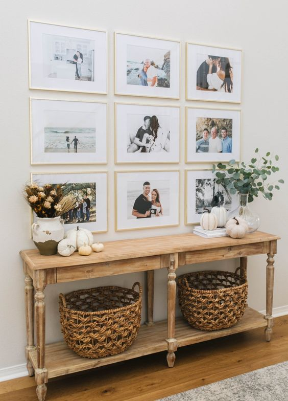 a modern grid gallery wall with matching gilded frames and colored family pics is a stylish idea to personalize your space