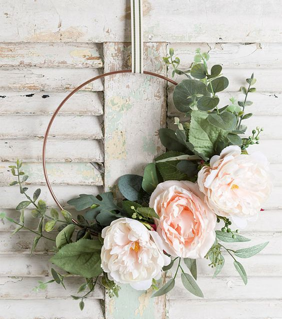 a modern hoop wreath with artificial foliage, large blooms is a lovely idea for spring, it's easy to compose