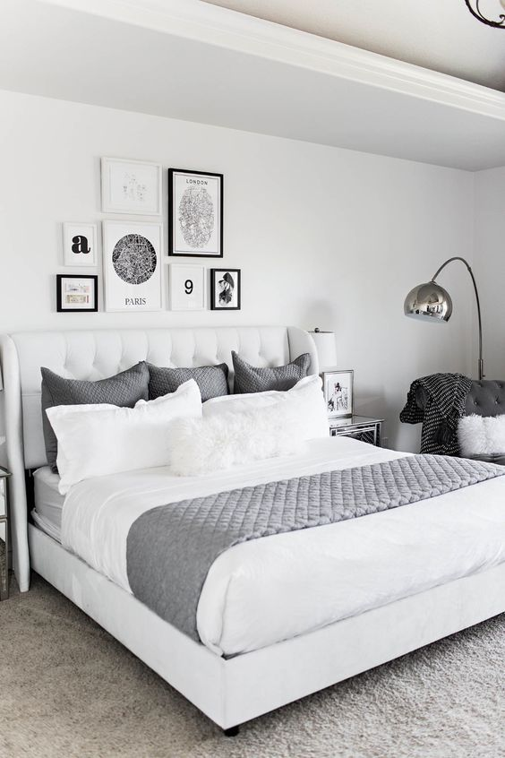a laconic Nordic gallery wall with mismatching black and white frames and a free form is a very catchy and fresh option
