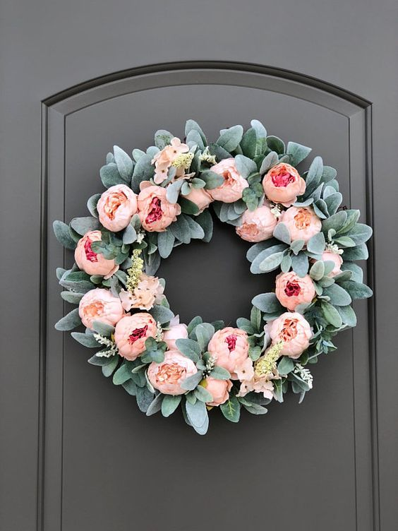 a romantic spring wreath of faux greenery, pink peonies and some more blooms is a very pretty and chic idea