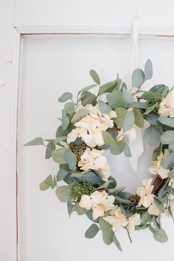 a simple and fresh spring wreath of vine, foliage and neutral blooms is a beautiful and cool decoration to make