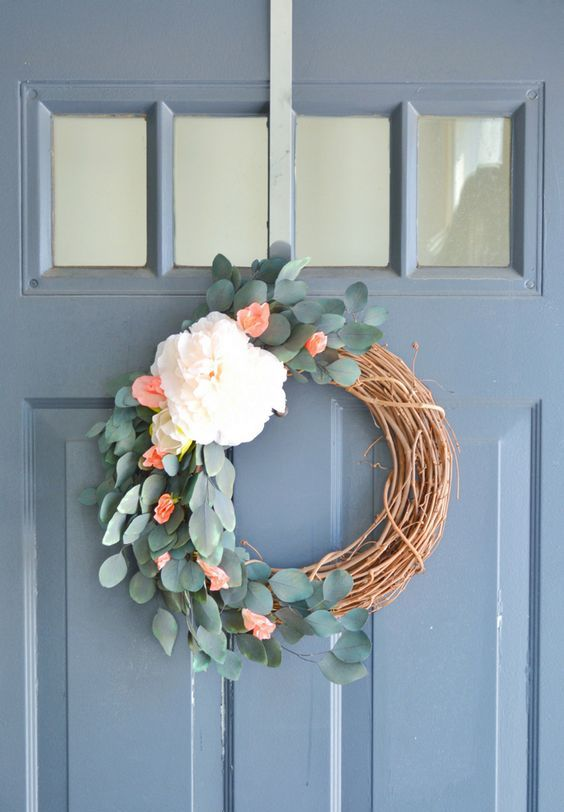 a simple and pretty rustic spring wreath of vine, eucalyptus, white and red blooms is a very lovely idea