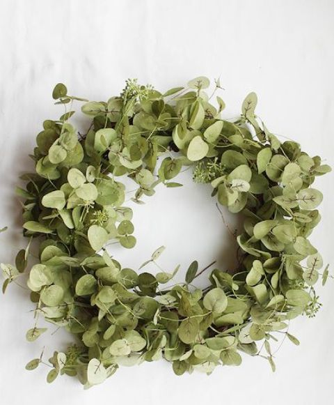 a simple eucalyptus wreath is a lovely spring decoration for your front door, and it won't wither