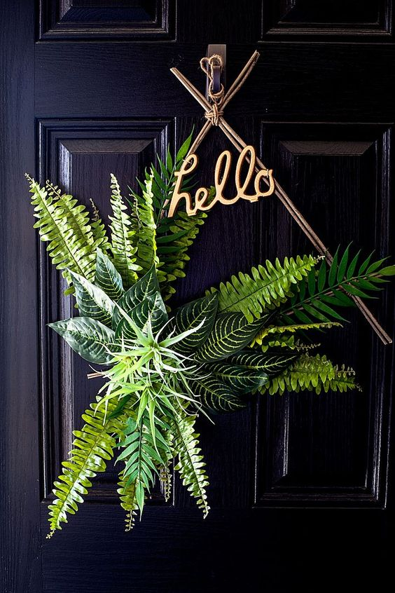 a fresh boho spring wreath of branches, greenery and air plants plus a HELLO calligraphy piece is amazing
