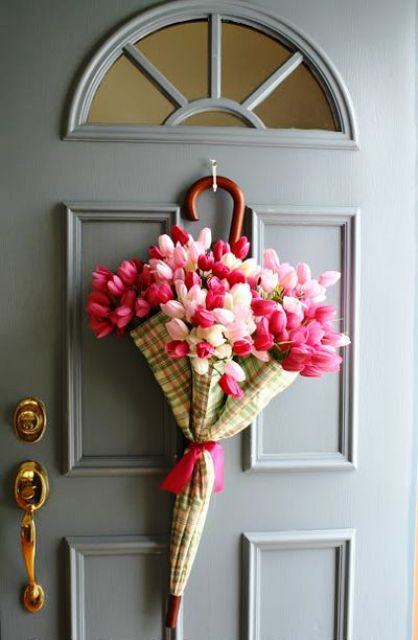 a plaid umbrella with pink and blush tulips is a pretty alternative to a usual spring wreath
