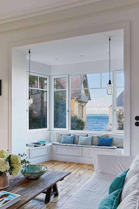 a coastal living room design with a bow window