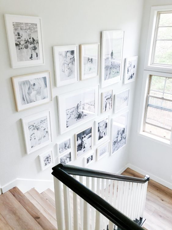 a beautiful free form gallery wall with white mismatching frames is a cool and chic idea and will add coziness