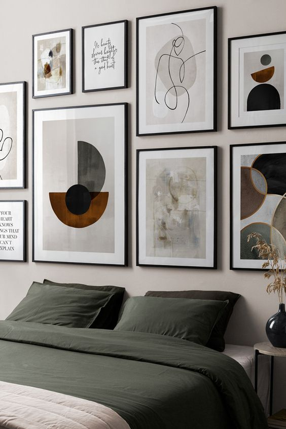 a beautiful gallery wall with thin black frames and white matting plus bold or muted color artworks or prints is wow
