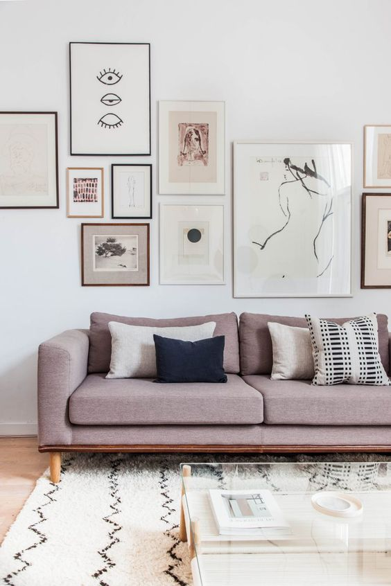 a beautiful modern gallery wall with thin black, white and brown frames, with abstract and other black and white and monochromatic art