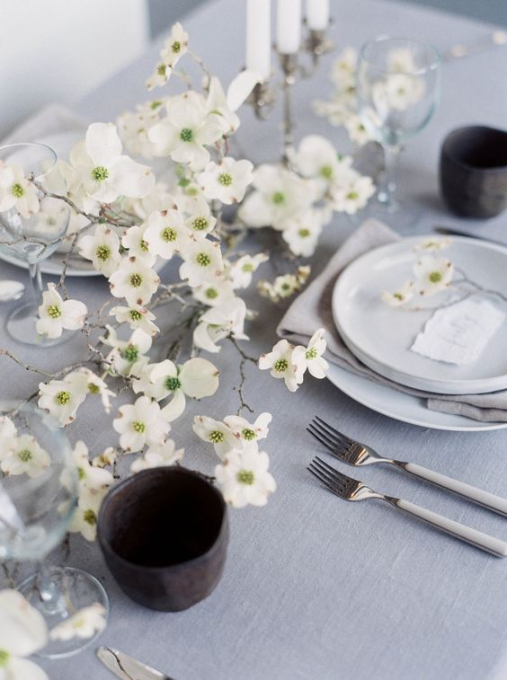 a beautiful white floral spring centerpiece right on the table is a fresh and romantic idea for a modern table